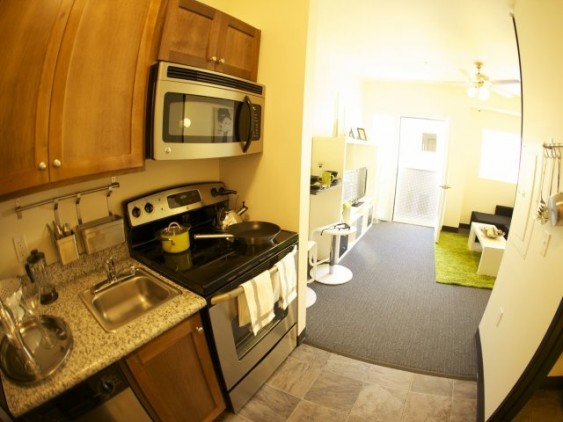 Kitchen and living space in small studio apartment at Freedom Center, Portland.