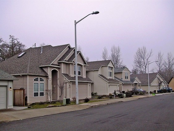 Garages dominate the fronts of single family homes.