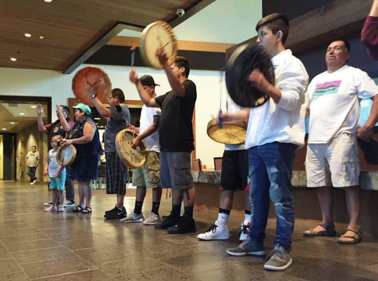 Lummi School students play traditional drums during a lunch the tribe hosted on Monday, May 9, at the Lummi Nation Administration Center to celebrate the U.S. Army Corps of Engineers' decision to reject a permit for a coal terminal at Cherry Point. Photo by Ralph Schwartz, all rights reserved.